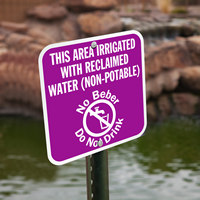 Bilingual Area Irrigated With Reclaimed Water Sign
