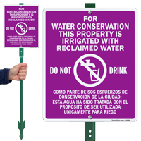 Bilingual Water Conservation Property Is Irrigated Sign